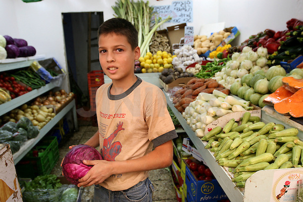 "Portrait of Halil,  an 11 year-old Palestinian boy who works in the west-Jerusalem market of ""Machane Yehuda"". July 3, 2008 . .Photo by : Tess Scheflan/ JINI"