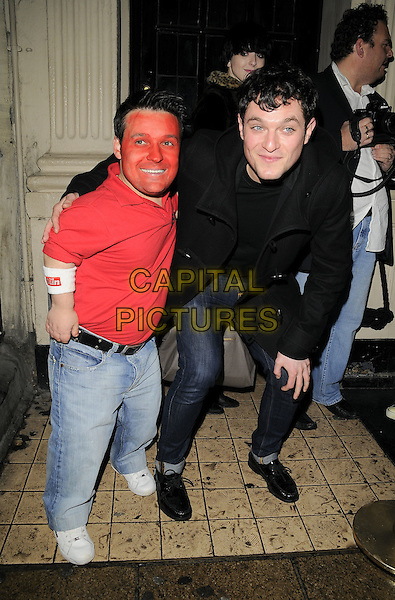 GUEST & MATTHEW HORNE .The Peaches Geldof for PPQ launch party at M*vida bar & nightclub, Argyll St., London, England..November 27th, 2008.movida full length black coat jacket jeans denim matt red top paint face tall short bending leaning .CAP/CAN.©Can Nguyen/Capital Pictures.