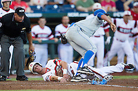 UCLA pitcher Nick Vander Tuig (21) tags out North Carolina State Wolfpack baserunner Jake Armstrong (23) at the plate during Game 8 of the 2013 Men's College World Series on June 18, 2013 at TD Ameritrade Park in Omaha, Nebraska. The Bruins defeated the Wolfpack 2-1, eliminating North Carolina State from the tournament. (Andrew Woolley/Four Seam Images)