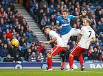 James Tavernier bullets a header towards goal