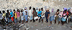 Women line up for food from the World Food Program during a massive distribution in Port-au-Prince, Haiti, less than three weeks after the January 12 earthquake that ravaged the Caribbean nation.