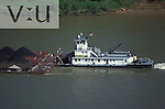 Towboat pushing barge loaded with coal up the Ohio River. Kentucky
