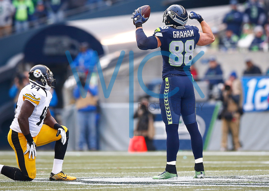 Jimmy Graham #88 of the Seattle Seahawks celebrates his first down catch in front of Lawrence Timmons #94 of the Pittsburgh Steelers in the first half during the game at CenturyLink Field on November 29, 2015 in Seattle, Washington. (Photo by Jared Wickerham/DKPittsburghSports)