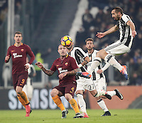 Calcio, Serie A: Juventus vs Roma. Torino, Juventus Stadium,17 dicembre 2016. <br /> Juventus&rsquo; Giorgio Chiellini, right, controls the ball past Roma&rsquo;s Radja Nainggolan, center, during the Italian Serie A football match between Juventus and Roma at Turin's Juventus Stadium, 17 December 2016.<br /> UPDATE IMAGES PRESS/Isabella Bonotto