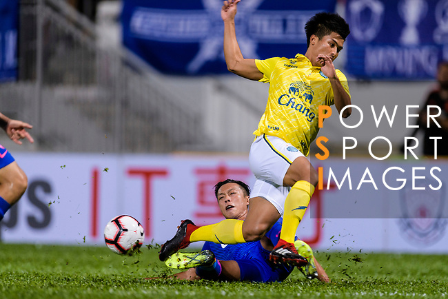 Kitchee Defender Tong Kin Man (L) trips up with Karrakot Wiriya-Udomsiri of Buriram (R) during the Preseason Friendly Match between Kitchee and Buriram United at Mong Kok Stadium on August 18, 2018 in Hong Kong. Photo by Marcio Machado/Photo by Marcio Machado/Power Sport Images