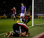 Leon Clarke of Sheffield Utd looks on as George Baldock of Sheffield Utd buries his head in his hands in frustration during the Championship match at Bramall Lane Stadium, Sheffield. Picture date 30th December 2017. Picture credit should read: Simon Bellis/Sportimage