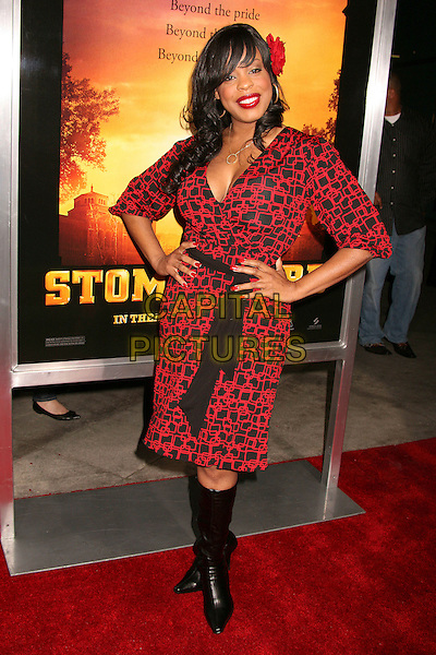 "NIECY NASH.""Stomp The Yard"" Los Angeles Premiere at Arclight Cinemas, Hollywood, California, USA, 8 January 2007..full length black and red patterned print wrap dress knee high boots hands on hips flower in hair clip wrap belt.CAP/ADM/BP.©Byron Purvis/AdMedia/Capital Pictures."