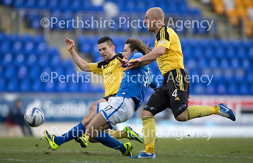 St Johnstone v Livingston.....30.11.13     Scottish Cup 4th Round<br /> Jason talbot and Simon Mensing close down Stevie May<br /> Picture by Graeme Hart.<br /> Copyright Perthshire Picture Agency<br /> Tel: 01738 623350  Mobile: 07990 594431