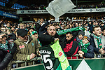 10.02.2019, Weserstadion, Bremen, GER, 1.FBL, Werder Bremen vs FC Augsburg<br /> <br /> DFL REGULATIONS PROHIBIT ANY USE OF PHOTOGRAPHS AS IMAGE SEQUENCES AND/OR QUASI-VIDEO.<br /> <br /> im Bild / picture shows<br /> ein glücklicher Fan der Sebastian Langkamp (Werder Bremen #15) Jubiläums-Trikot / Spieltags-Trikot gefangen hat, <br /> <br /> Foto © nordphoto / Ewert