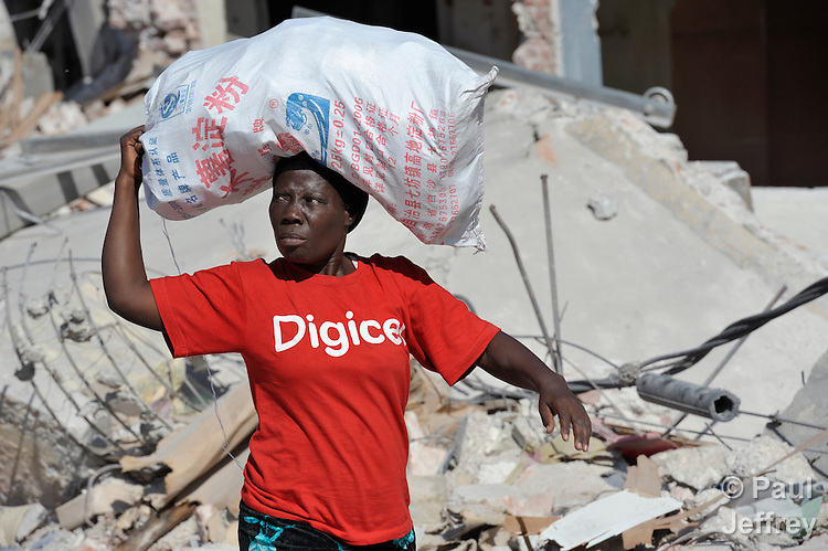 A woman walks in Port-au-Prince, Haiti, much of which was devastated in a January 12 earthquake.