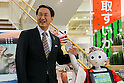 (L to R) Shinji Hirai governor of Tottori Prefecture and the humanoid robot Pepper pose for the cameras during the debut of Pepper as a new member of staff at the ''Tottori Okayama Shimbashi-kan'' store on July 1, 2015, Tokyo, Japan. The robot developed by SoftBank Corp. is programmed to interact with people and it is claimed that it can provide reception services in commercial establishments. Pepper will introduce the store's products and services to customers as a special employee for two days. The Tottori Okayama Shimbashi-kan sells unique food and traditional handicraft products from Tottori and Okayama prefectures in western Japan. (Photo by Rodrigo Reyes Marin/AFLO)