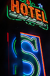 Detail of a neon light on the Shiva Hotel in the Paharganj district of New Delhi,  India.