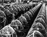 Long Beach, California, 1942 - Production. A-20 attack bombers. Women workers at the Long Beach, California plant of Douglas Aviation Company groom lines of transparent noses for deadly A-20 attack bombers. The A-20 is used by the American Air Force and RAF (Royal Air Force) for hedge hopping and strafing operations against ground troops and installations; also for reconnaissance work and night fighting. It is armed with light and heavy caliber guns in varying combinations. Photograph by Alfred Palmer