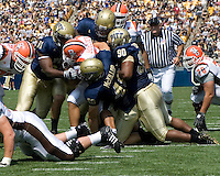 Pitt defensive lineman Greg Romeus (#91), linebacker Scott McKillop (#40) and defensive lineman Tony Tucker (#90) gang up on Bowling Green running back Chris Bullock. The Bowling Green Falcons defeated the Pitt Panthers 27-17 on August 30, 2008 at Heinz Field, Pittsburgh, Pennsylvania.