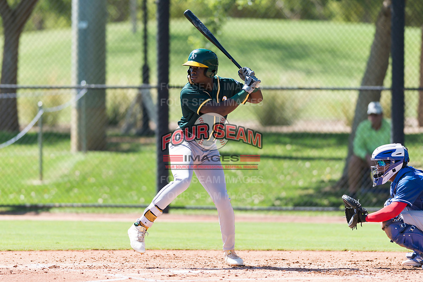 Oakland Athletics right fielder Lawrence Butler (14) at bat during an Instructional League game against the Los Angeles Dodgers at Camelback Ranch on September 27, 2018 in Glendale, Arizona. (Zachary Lucy/Four Seam Images)