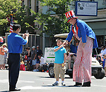"A young onlooker, is selected for an individual greeting by ""Uncle Sam"" depicted by, David Cardall, 70, of Saugerties, during the Independence Day Parade, in Saugerties, NY on Thursday, July 4, 2013. Photo by Jim Peppler. Copyright Jim Peppler 2013 all rights reserved."