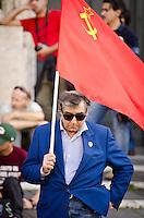ITA: Un anziano signore, ben vestito, con in mano una bandiera rossa dell'Unione Sovietica Roma 19 Ottobre 2013. Decine di migliaia di persone sono scese in piazza per protestare contro le misure di austerità e tagli di bilancio in Italia. (Foto di Adamo Di Loreto/BuenaVista*photo) ENG: An older gentleman, well dressed, holding a red flag of the Soviet Union on October 19, 2013 in Rome. Tens of thousands of people took to the streets to protest against the austerity measures and budget cuts in Italy. (Photo credit Adamo Di Loreto/BuenaVista*photo)