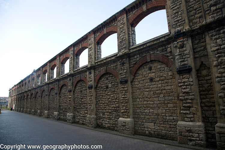 Retained wall of one of the GWR railway workshops, Swindon, England