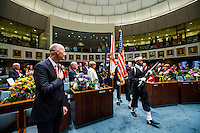TALLAHASSEE, FLA. 3/3/15-Gov. Rick Scott, left, watches the Navy Reserve color guard enter the Senate Chamber during the opening day of the 2015 Legislative Session Tuesday at the Capitol in Tallahassee.<br /> <br /> COLIN HACKLEY PHOTO