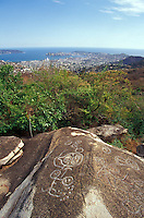 Pre-Columbian petroglyphs with the city of Acapulco in the background, Palma Sola archaeological site, Acapulco, Mexico