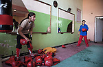4 APRIL 2012, Kabul, Afghanistan:  Young athelets Somaya (left) and Shermila (18) warm up for boxing training at the Ghazi Olympic Stadium in Kabul that was formerly the site of public be-headings during the Taliban years. The girls have bucked the conservative elements of society to take part in training and are aiming to compete at the elite level of the sports at the Olympic Games. Picture by Graham Crouch/The Australian