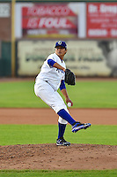 Victor Gonzalez (22) of the Ogden Raptors in action against the Great Falls Voyagers in Pioneer League action at Lindquist Field on July 18, 2014 in Ogden, Utah.  (Stephen Smith/Four Seam Images)