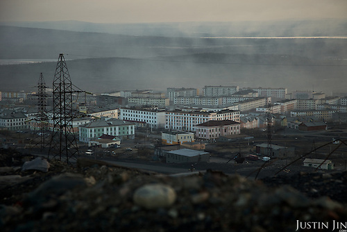 Gases emitted from the nickel mining combine hangs over the Russian Arctic town of Nikel and kills almost all vegetation within sight. The combine, built in 1937 during Stalin's reign, emits five times more sulphur dioxide -- the cause of acid rain -- than the whole of Norway just seven kilometres away on the Russian border..In 2001, Norway gave Norilsk Nickel, the head company, 32 million euros to modernise the facility and cut pollution. The money disappeared, but the factory was not improved..Sulphur dioxide emitted from the factory kills vegetation, pollutes ground water and causes asthma, especially among children.