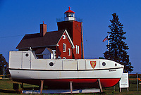 "THE TWO HARBORS LIGHTHOUSE AND HISTORICAL FISHING BOAT THE ""CRUSADER II""  IN TWO HARBORS, MINNESOTA."