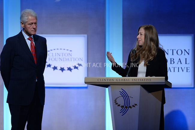 WWW.ACEPIXS.COM<br /> September 22, 2014 New York City<br /> <br /> Former U.S. President Bill Clinton and daughter, vice chair of the Clinton Foundation Chelsea Clinton address the audience during the Opening Plenary Session discussion for the Clinton Global Initiative on September 22, 2014 in New York City.<br /> <br /> <br /> By Line: Kristin Callahan/ACE Pictures<br /> ACE Pictures, Inc.<br /> tel: 646 769 0430<br /> Email: info@acepixs.com<br /> www.acepixs.com
