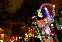 A colorful court jester juggles balls to delight Charlotteans attending First Night Charlotte 2010. The family-friendly public event (no alcohol allowed) is an annual cultural New Year's Eve celebration held in downtown / uptown / Charlotte center city. Charlotte First Night - An Imagination Celebration brought together artists, musicians, dancers and more from across the country. The New Year's event is organized by Charlotte Center City Partners, which facilitates and promotes the economic and cultural development of this North Carolina urban core.