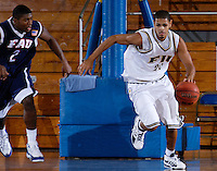 Florida International University Golden Panthers versus the Florida Atlantic University Owls at Pharmed Arena, Miami, Florida on Thursday, December 28, 2006.  FAU's DeAndre Rice sunk a three-point shot with 5.9 seconds left in the game to lift the Owls to a 68-66 win over the Golden Panthers...Senior guard Johwen Villegas (20)<br />