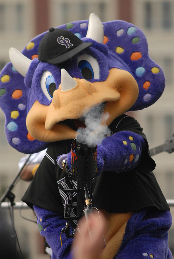"""Colorado Rockies mascot """"Dinger"""" shoots t-shirts into a crowd gathered to watch a downtown denver event to celebrate the accomplishments of the 2007 Colorado Rockies."""