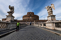 A woman run on ponte Sant'Angelo, also know as Bridge of Angels, lead to Sant'Angelo castle, during Italy's lockdown due to Covid-19 pandemic. <br /> On May 4th will start the phase 2 of the measures against pandemic, adopted by Italian government, that will allow some construction and factory workers to go back to work . <br /> Rome 30/04/2020 <br /> Photo Andrea Staccioli Insidefoto