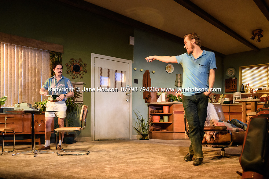 "London, UK. 29.11.2018. The first UK production, since the death of playwright Sam Shepard's play ""True West"", opens at the Vaudeville Theatre, directed by Matthew Dunster. Kit Harington and Johnny Flynn star, as brothers Austin and Lee, with Madeleine Potter and Donald Sage Mackay completing the cast. Picture shows: Kit Harington (Austin) and Johnny Flynn (Lee). Photograph © Jane Hobson."