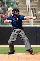 Home plate umpire Joseph Born calls a batter out on strikes during a South Atlantic League game between the Delmarva Shorebirds and the Kannapolis Intimidators at Fieldcrest Cannon Stadium June 2, 2009 in Kannapolis, North Carolina. (Photo by Brian Westerholt / Four Seam Images)
