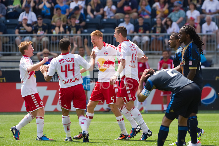 Markus Holgersson (5) of the New York Red Bulls celebrates scoring with teammates. The New York Red Bulls defeated the Philadelphia Union  3-2 during a Major League Soccer (MLS) match at PPL Park in Chester, PA, on May 13, 2012.