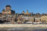 Chateau Frontenac, opened 1893, designed by Bruce Price as a chateau style hotel for the Canadian Pacific Railway company or CPR, with the Saint Lawrence river and Petit Champlain below, in Quebec City, Quebec, Canada. On the right is the Louis S St-Laurent Building, built 1872-73 in Second Empire style, the Old Post Office. The Chateau Frontenac was extended and the central tower added in 1924, by William Sutherland Maxwell. It is now a hotel, the Fairmont Le Chateau Frontenac, and is listed as a National Historic Site of Canada. The Historic District of Old Quebec is listed as a UNESCO World Heritage Site. Picture by Manuel Cohen