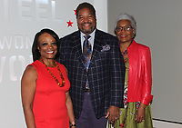 NWA Democrat-Gazette/CARIN SCHOPPMEYER Deborah Wright (from left), Tony Waller and Esther Silver-Parker enjoy the Men of Steel, Women of Wonder preview.