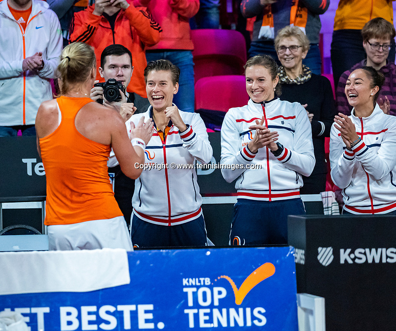 The Hague, The Netherlands, Februari 7, 2020,    Sportcampus, FedCup  Netherlands -  Balarus, Seccond match on friday:  Kiki Bertens puts The Netherlands in the lead 1-0 and celebrates with het teammates.<br /> Photo: Tennisimages/Henk Koster