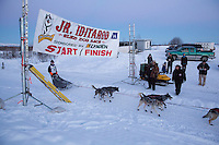 Benjamin Harper crosses the finish line of the 2014 Jr. Iditarod Sled Dog Race in second place at Happy Trails Kennel, Big Lake, Alaska<br /> Sunday February 23, 2014 <br /> <br /> Junior Iditarod Sled Dog Race 2014<br /> PHOTO BY JEFF SCHULTZ/IDITARODPHOTOS.COM  USE ONLY WITH PERMISSION