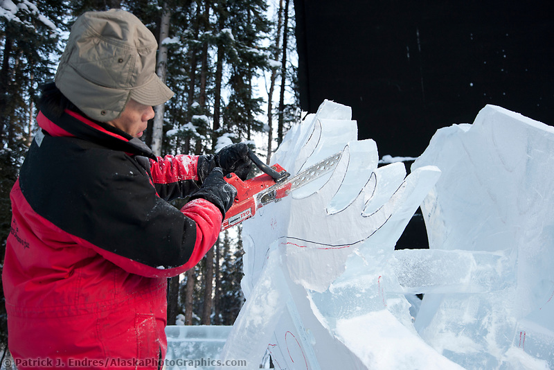 "Fukumi Furukawa, Japan, works on the antlers of a caribou for the multi block sculpture titled ""White Fang"" for the 2009 World Ice Art Championships in Fairbanks, Alaska. Team members: Junichi Nakamura, Shinichi Sawamura, Fukumi Furukawa, Takao Waki."