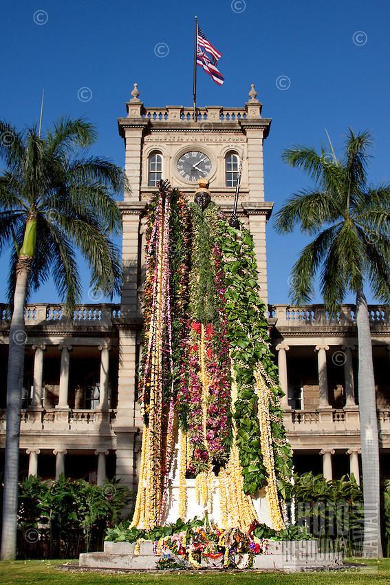 Statue of King Kamehameha I, draped with flower leis in honor of Kamehameha Day, in front of Aliiolani Hale, Honolulu, Hawaii