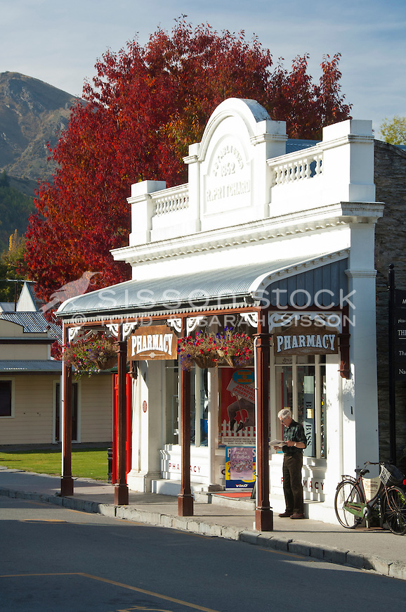 Sunlight on the store front of Arrowtown Pharmacy in the tourist village of Arrowtown, Central Otago