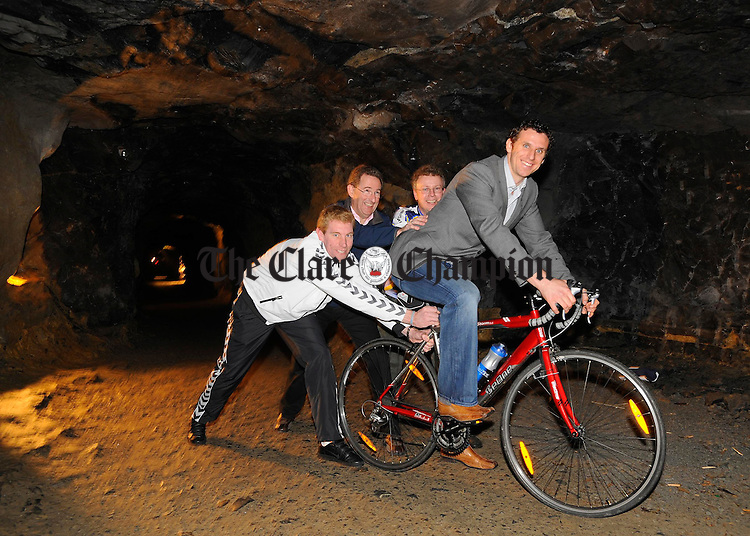 Clare hurler Tony Griffin takes to his bike in Ailwee cave at the launch of the An Post Tour De Burren which takes on Saturday June 21st at Ballyvaughan. Giving him some encouragement  in the rocky terrain were Nigel Forde, Galway Bay Cycling Club, Barney Whelan, An Post and Adam Johnson, Ailwee Cave. Photograph by John Kelly.