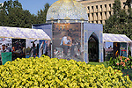 An ornate tent housing photographs displaying the culture and lifestyles of the Iranian people