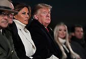 United States President Donald J. Trump and first lady Melania Trump participate in the Lighting Ceremony during the 2018 National Christmas Tree Lighting Ceremony at the Ellipse near the White House on November 28, 2018 in Washington, DC.<br /> Credit: Oliver Contreras / Pool via CNP