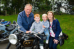 Tony Cahillane Brosna, Jamie, Shane and Louise McCarthy Abbeyfeale check out the motorbikes at the Paudie Fitzmaurice memorial tractor run into Cordal on Sunday