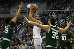 Nevada's Caleb Martin looks to pass against Colorado State in the first half of an NCAA college basketball game in Reno, Nev., Sunday, Feb. 25, 2018. (AP Photo/Tom R. Smedes)