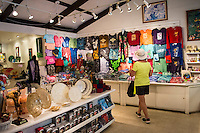 A woman strolls through the gift shop at Hawaii Tropical Botanical Garden in Papa'ikou near Hilo, Big Island of Hawai'i.