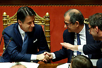 The Italian Premier Giuseppe Conte and Minister of Economy Giovanni Tria<br /> Rome December 19th 2018. Senate. Speech of the Italian Premier about the results of the negotiation with the European Union about the  budget plan.<br /> Foto Samantha Zucchi Insidefoto